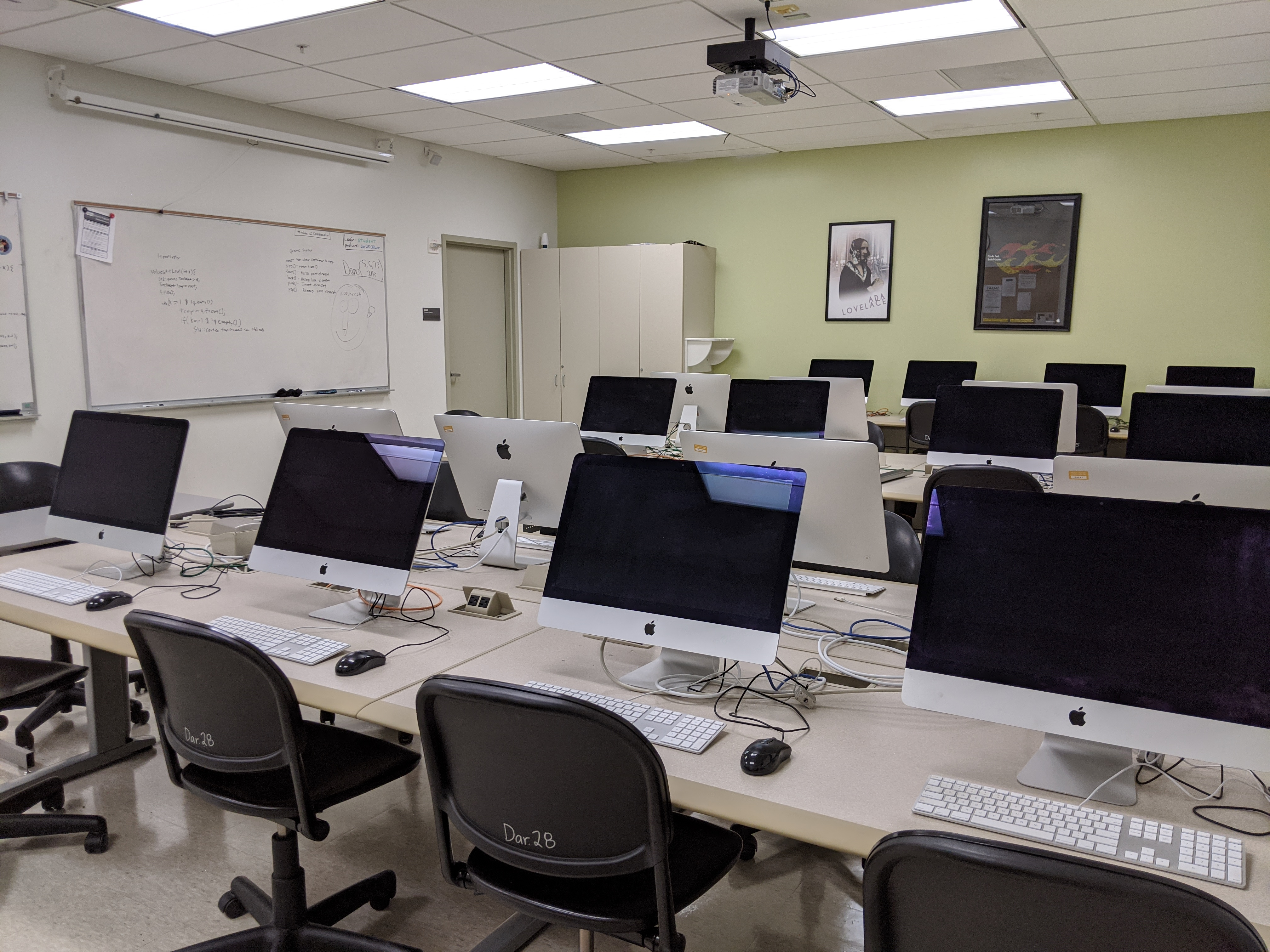 Empty computer lab with rows of computers